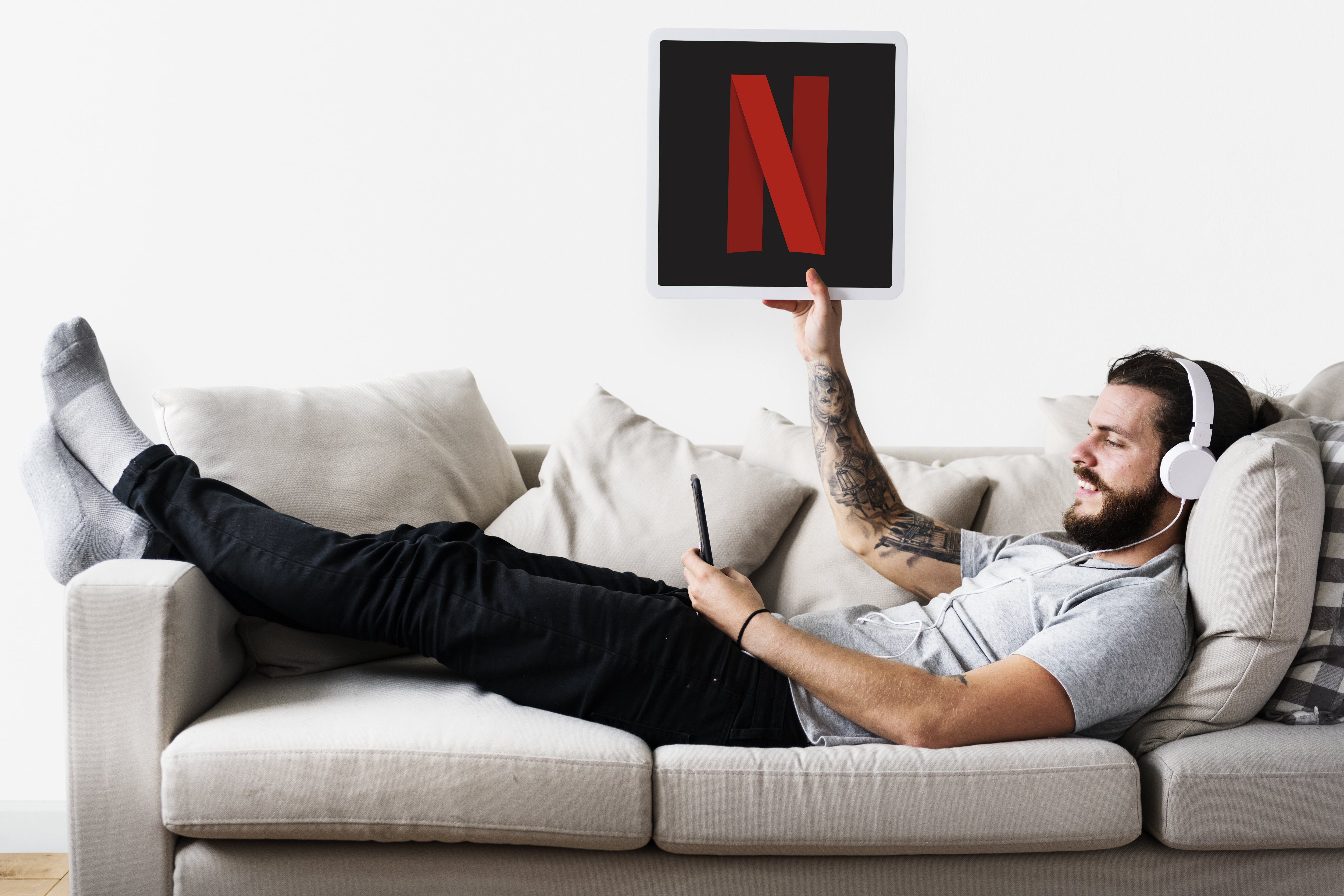 man-showing-netflix-icon-min