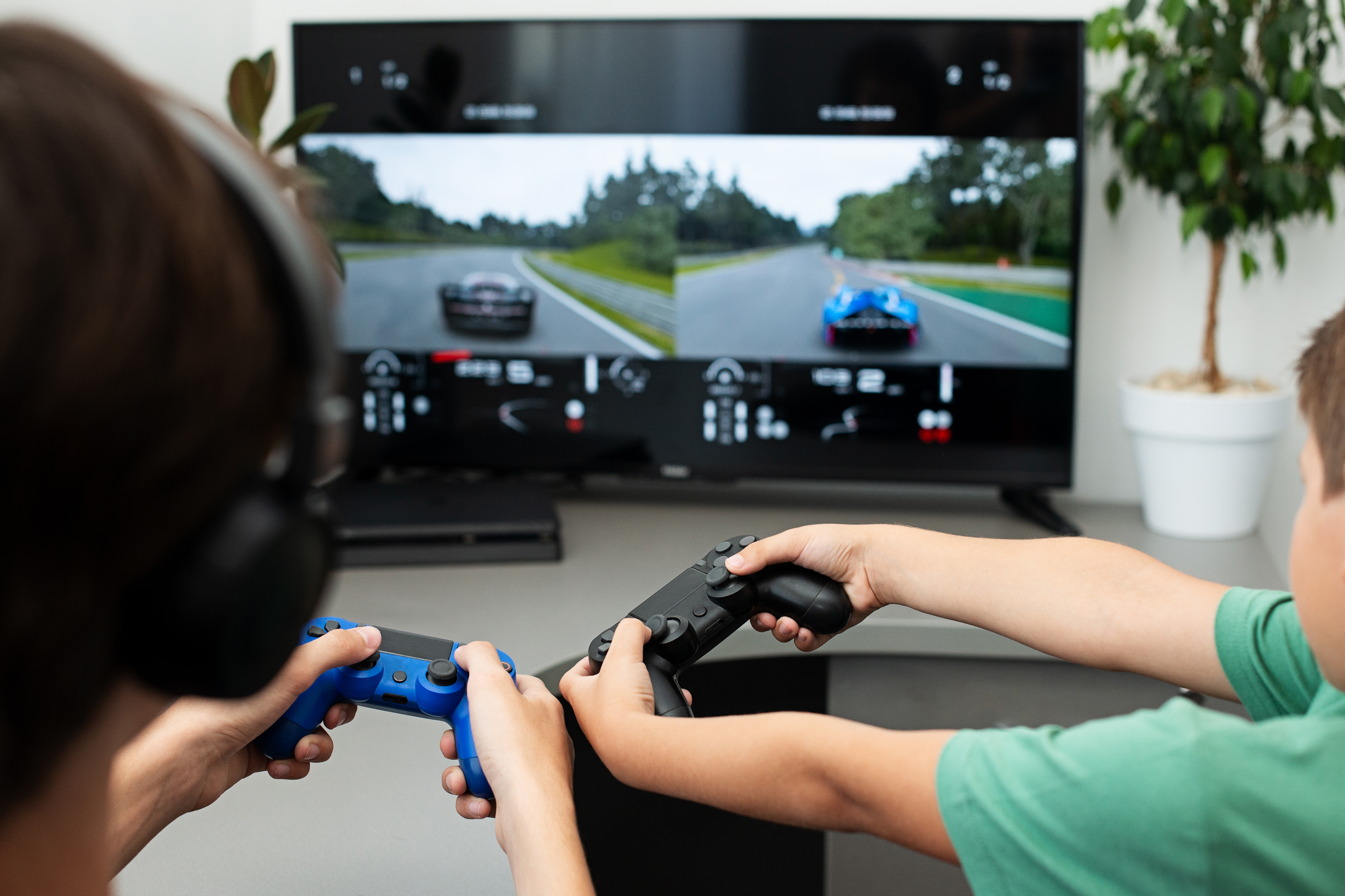 teenager-plays-computer-game-with-headphones-and-joystick